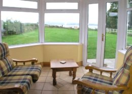 Kinnegar Beach Cottage Rathmullan - sunroom and rear garden
